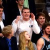 Senior Will Kaiser pokes fun at the opposite student section. Photo by Hailey Hughes