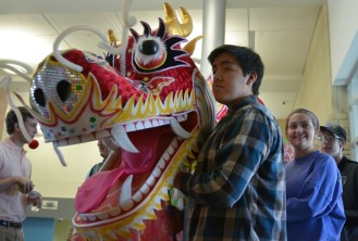 Alex Bulbarela gets ready in the hallway before performing a dragon dance. Photo by Annie Lomshek.