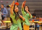 Chinese heritage dancers perform using umbrellas and fans. Photo by Annie Lomshek.