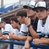 Players watch nervously from the dugout, knowing it could be their last game. Photo by James Wooldridge