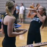 Freshman Lancer Dancer Sarah Grimm catches a pancake that was flung by the pancake-maker. Photo by Abby Blake