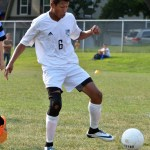 Senior Eloy Flores kicks the ball away from an opposing player. Photo by Abby Blake