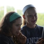Junior Rebecca Sheridan and sophomore Julia Stopperan  pick the next game for the team to play. Photo by Haley Bell