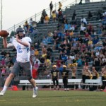 Junior Luke Kaiser attempts to pass to a receiver.  Photo by Tess Iler