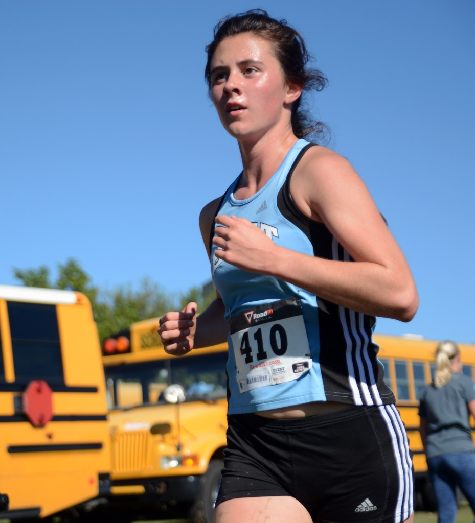 Sophomore Madeline Hlobik competes in the Varsity race. Photo by Morgan Browning