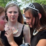 Freshman JV Lancer Dancer Megan Walstrom fixes Freshman cheerleader Lizzie Kahle's lipstick before the parade. Photo by Hannah McPhail