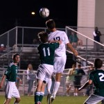 Senior Luke Ehly heads the ball above the player from South. Photo by Ellie Thoma