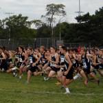 The JV/C- team boys race begins.  Photo by Tess Iler