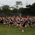 The JV/C- team boys race begins.  Photo by Tess Iler