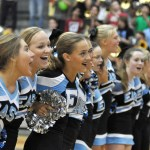 Cheerleader and Lancer Dancers come together to sing the school song. Photo by Ellie Thoma