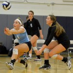 Juniors Ally Huffman and Sydney Ashner go in for the pass. Photo by Abby Blake
