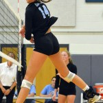 Junior Sarah Maddox hits the ball across the net. Photo by Abby Blake