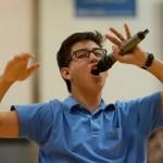 "Senior Andrew Stottle teaches the senior section the ""Do it"" chant. Photo by Joseph Cline"