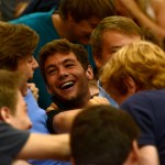 """Junior Grayson Rapp is trampled by his friends after the """"Go Bananas"""" chant. Photo by Joseph Cline"""