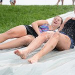 Seniors Hannah Eldred and Erin Staehr end their day with going down the slide a final time. Photo by Morgan Browning