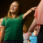 """Junior Kylie Ledford dances during the last song of the dress rehearsal, """"Life is a Highway"""". Photo by Morgan Browning"""
