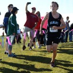 Freshman Jacob Tilton sprints towards the finish line in the C-team race. Photo by Morgan Browning