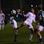 Junior Greyson Rapp fights for the ball. Photo by Diana Percy