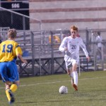 Junior Tommy Kerr dribbles towards an opponent.  Photo by Tess Iler