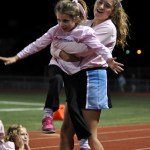 Sophomore Sophie Smith carries little Lancer back to her spot. Photo by Ellie Thoma