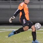 Goalie and sophomore Collyn Lowry  kicks the ball down the field  to his teammates. Photo by Abby Blake