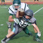 Freshman Garret Boschen gets tackled from behind while trying to run the ball. Photo by Abby Blake