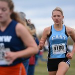 Sophomore Ingrid Worth pushes to get past a SMNW Cougar. Worth finished the race with a 20:15:90. Photo by Joseph Cline