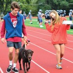 Senior Oscar Motsinger and his sophomore sister, Kirby, walk their dog, Sputnik, home from the pageant. Photo by Diana Percy