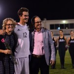 Senior Luke Ehly stands with his parents after he is announced on senior night. Photo by Diana Percy