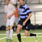 Junior Clayton Philips eyes the ball passed to him by his teammate. Photo by Kaitlyn Stratman
