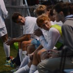 Senior Luke Ehly listens to his teammate on the sidelines. Photo by Kaitlyn Stratman