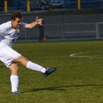 Sophomore Max Maday kicks the ball down the field to his teammate. Photo by Kaitlyn Stratman