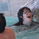 Senior Chloe Neighbor laughs after falling into the pool. Photo by Abby Blake