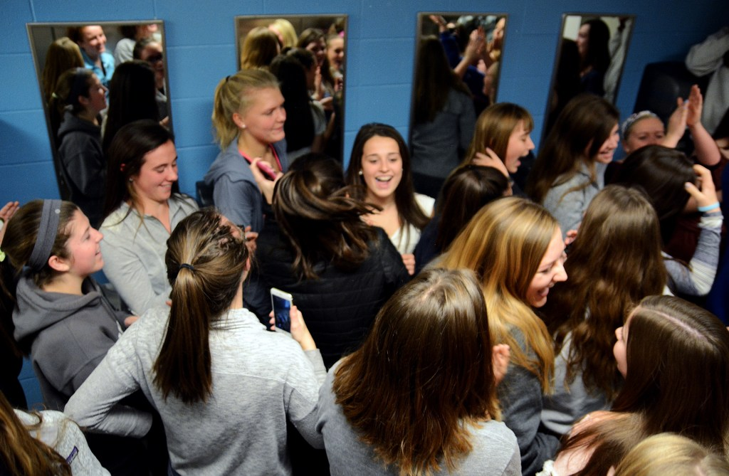 """Freshmen to senior girls continually chant """"La Toilette"""" in the fifth floor girls' bathroom, while senior Sarah Allegri plays music with her speaker. """"La Toilette"""" is a club made up of about 165 girls. Photo by Morgan Browning"""