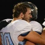 Senior Will Kost hugs a teammate after the loss. Photo by Haley Bell