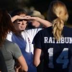 Junior Kalin Lamus blocks the sun from her eyes while listening teammates to the varsity football players' feedback. Photo by Kaitlyn Stratman