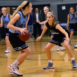 Sophomore and varsity basketball player Toni Englund tries to block Junior Lilly Flint. Photo by Diana Percy