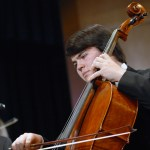 Senior Joe Levin plays the cello during the chamber orchestra performance.  Photo by Tess Iler