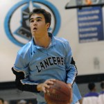 Senior Luke Ehly prepares to shoot a jumpshot during warmups.  Photo by Tess Iler