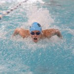 Freshman Sam Bruck competes in the 200 yard IM. Photo by Haley Bell
