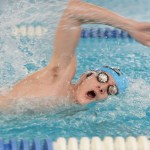 Freshman Michael Spivak competes in the 50 yard freestyle. Photo by Haley Bell