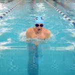 Senior Avery Bolar competes in the 100 yard breaststroke. Photo by Haley Bell