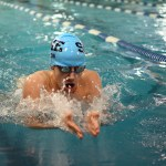 Junior Monty Lyddon competes in the 100 yard breaststroke. Photo by Haley Bell