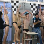 East swimmers celebrate as East beats BVN in the final event of the meet, the 400 yard freestyle relay. Photo by Haley Bell