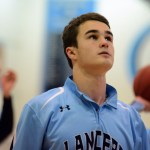 Senior Luke Ehly watches his ball go into the basket while his other teammates warm-up. Photo by Morgan Browning