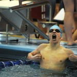 Sophomore Aidan Holbrook celebrates after taking first place in the 500 yard freestyle with a time of  4:39.63. Photo by Haley Bell