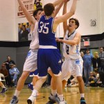 Sophomores Will Curran and Seamus Carroll block a shot. Photo by Diana Percy