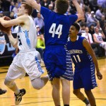 Senior Henry Sullivan shoots the ball around a Leavenworth player. Photo by Diana Percy