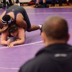 With Coach coaching him, sophomore OJ Ludwig wrestles his opponent. Photo by Morgan Browning
