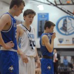 Seamus Carroll waiting to rebound free throw. Photo by Audrey Kesler